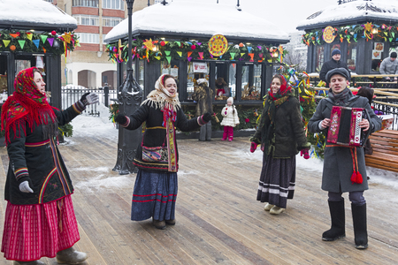 Moscow, Russia -  February 17, 2018: Costume performance on Shrovetide festivities - dances and songs. Participants are dressed in traditional Russian clothes of the early 20th century.