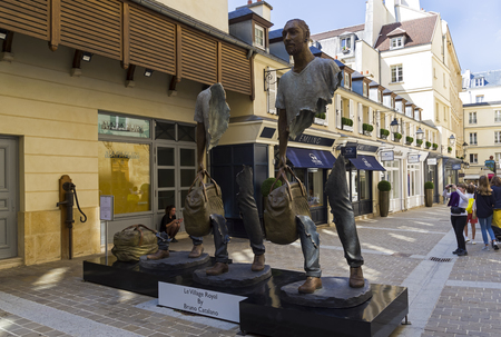 Paris, France - September 3, 2018: Street exposure of the artworks of Bruno Catalano on the Parisian shopping street Le Village Royal. Editorial