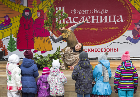 Moscow, Russia -  February 17, 2018: The performance of the Yakut theater Olonkho at the Pancake Week festival in Moscow. Children at the scene look at the show. February 2018.