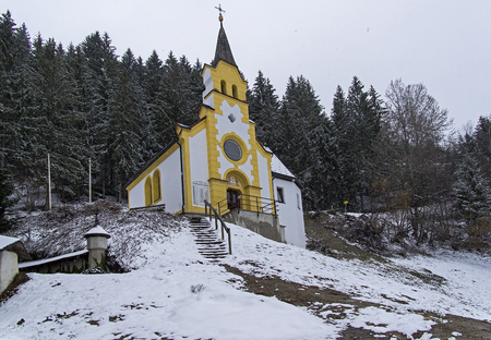 Little chapel in the forest on the mountainside. Zillertal Valley, above the town Zell am Ziller, Tyrol, Austria.