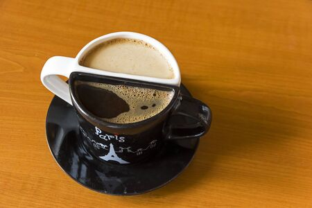 Unusual coffee cups with coffee.