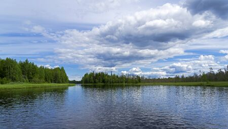 Beautiful clouds over the reach on the river Keret. Karelia, Russia, end of June. Stock fotó