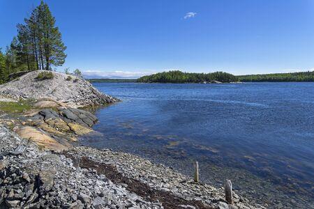 The shore of the White Sea on a sunny summer day. Kandalaksha Gulf, White Sea, Karelia, Russia, end of June.