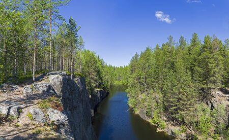 Forest lake in a rocky canyon. The coast of the White Sea.Kandalaksha Gulf, Karelia, Russia, end of June.