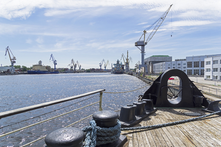 View from the deck of the Krasin icebreaker (now a museum ship, moored at the embankment of Lieutenant Schmidt) to cranes of the Baltic Shipyard and Admiralty Shipyard. Saint Petersburg, Russia.
