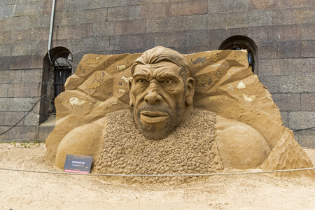 Saint Petersburg, Russia - June 13, 2019: The exhibition of sand sculptures at the Peter and Paul Fortress. Composition Stone Age by author Ruslan Arslanbaev from St. Petersburg, Russia. 新聞圖片