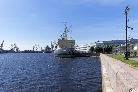 Saint Petersburg, Russia - June 12, 2019: Icebreaker Krasin (now a museum ship) at the embankment of Lieutenant Schmidt against the background of cranes of the Baltic Shipyard and Admiralty Shipyard.