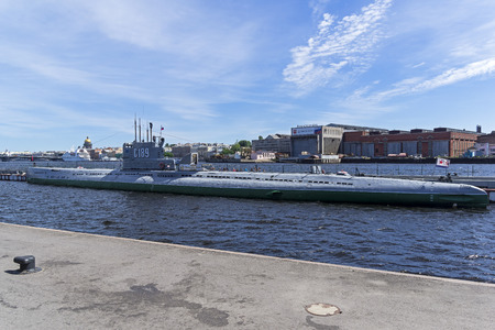 Saint Petersburg, Russia - June 12, 2019: Museum Old Soviet Submarine against the backdrop of the Admiralty Shipyards.. Saint Petersburg, Russia.