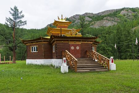 Wooden pagoda in a Buddhist datsan in the village of Orlik. Buryatia, Russia.