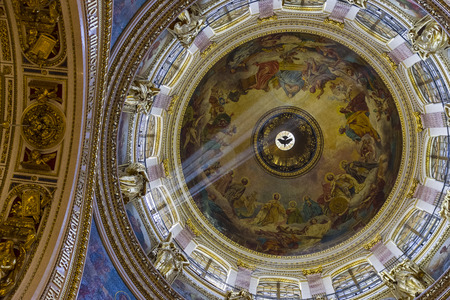 Ray of light under the dome of the Orthodox Cathedral.Saint Isaac's Cathedral,  Saint Petersburg, Russia. Редакционное