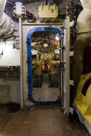 Saint Petersburg, Russia - June 12, 2019: Inside the museum old Soviet submarine. Tight door between compartments. Saint Petersburg, Russia.