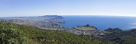Panorama of the Black Sea coast - a view from the Perchem mountain on the resort town of Sudak and Kapselsky bay. Crimea. Sunny day in September.