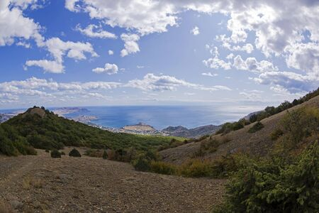 View from the top of Mount Perchem to the Black Sea coast near the resort town of Sudak, Crimea. Sunny day in September. 版權商用圖片