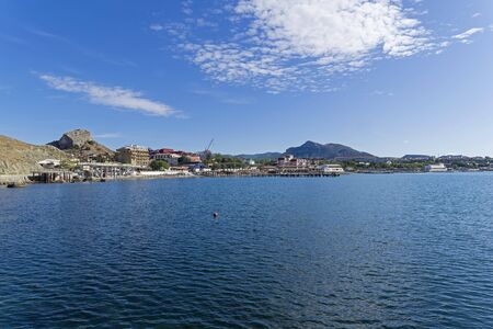 Panorama of the bay of the resort town of Sudak, Crimea. Sunny day in September.