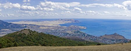 Panoramic view from the top of Mount Perchem to the Black Sea coast near the resort town of Sudak, Crimea. Sunny day in September.