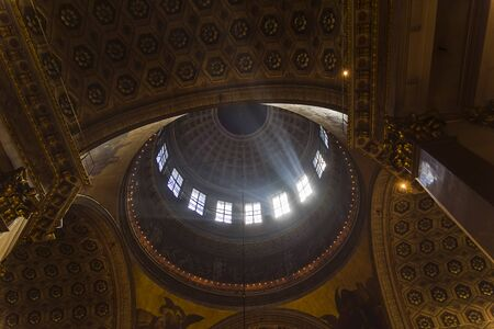Rays of light under the dome of the Orthodox Cathedral. Kazan Cathedral, Saint Petersburg, Russia. 版權商用圖片