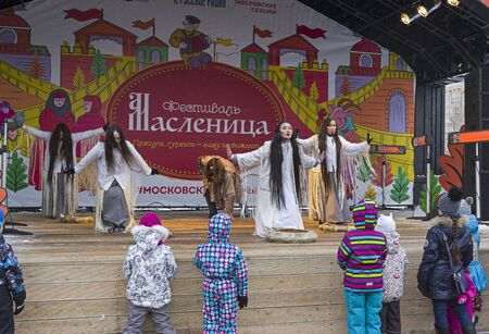 Moscow, Russia -  February 17, 2018: The open-air performance of the Yakut theater Olonkho at the Pancake Week festival in Moscow. Children at the scene look at the show. February 2018.