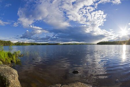 Beautiful clouds over the reach on the river Keret. Karelia, Russia, end of June. 版權商用圖片