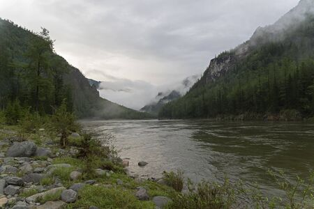 The beginning of the Orkho-Bom gorge, along this gorge the Sayan Oka  river crosses the Sayansk ridge. Buryatia, Siberia, Russia. 版權商用圖片