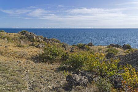 The shore of the Black Sea. Cape Meganom, Crimea, a sunny day in September.