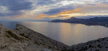 Sunset on the Black Sea coast of Crimea. View from the top of Cape Alchak to the west, towards Novyy Svet.
