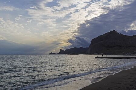 Sunset in the bay of the resort town of Sudak. Crimea.