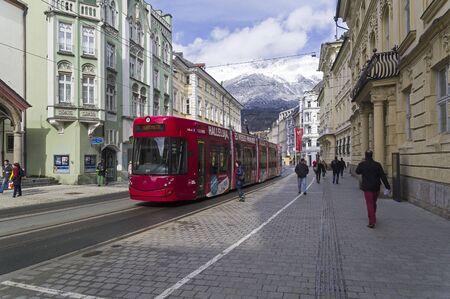 Innsbruck, Austria - March 3, 2020: Tram at the stop. Street of Maria Theresa in Innsbruck, Austria. Early March.