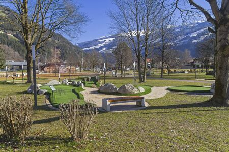 Beautiful landscaped park with playgrounds in the ski resort of Zell am Ziller, Tyrol, Austria. Sunny day in early March.