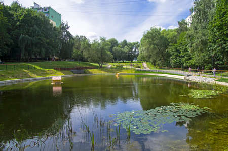 Moscow, Russia - August 4, 2020: A small beautiful pond in a residential area of the city.