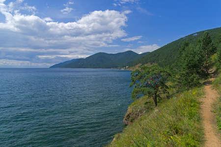 Great Baikal Trail in Pribaikalsky National Park, Irkutsk region. The surroundings of the Bolshiye Koty village. Sunny day in August.