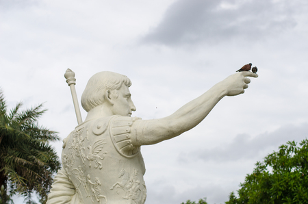 Statue of a man with bird island