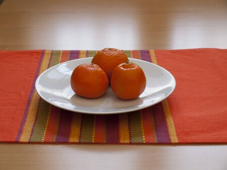 Close up view of organic Mandarins in a plate