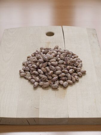 Close up view of organic Pinto beans on a board