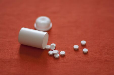 Arnica: Close up view of Arnica pills Stock Photo