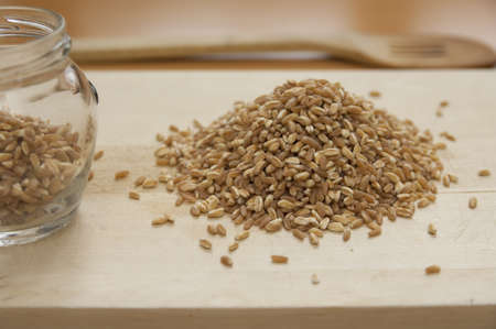Close up view of organic Spelt on a board