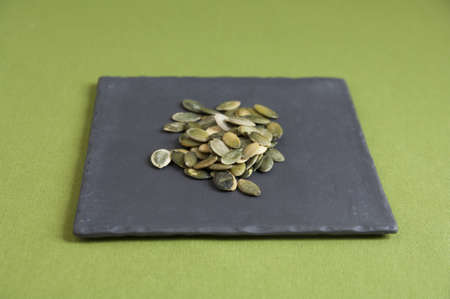 Close up view of organic Toasted Pumpkin Seeds in a plate Stock Photo