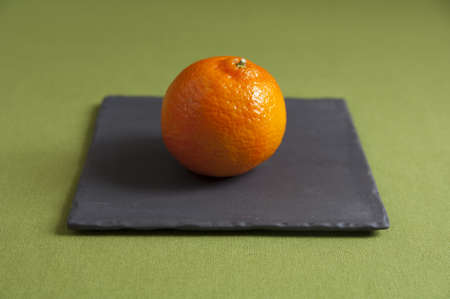 Close up view of organic Mandarins on a plate