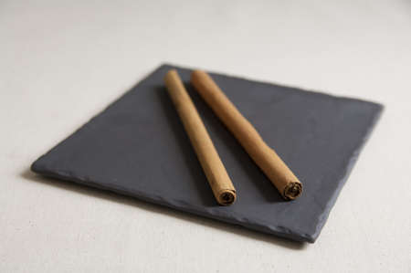 Close-up view of Cinnamon Stick on a plate Stock Photo