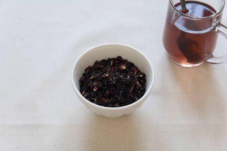 Dried Herbs and Fruits Preaparation in a bowl and Herbal Tea in a cup  photo