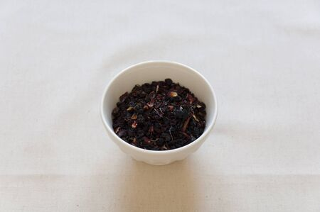 Dried Herbs and Fruits Preaparation for Herbal Tea in a bowl  photo