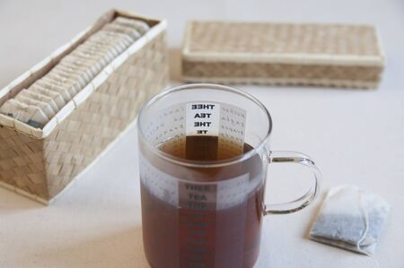 Close-up view of a cup of organic tea against a withe background
