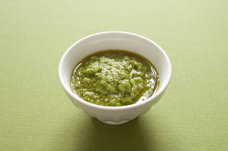 Close-up view of organic italian traditional Pesto sauce in a bowl Stock Photo - 17825012