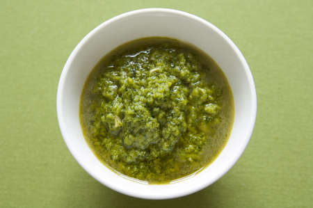 Close-up view of organic italian traditional Pesto sauce in a bowl Stock Photo - 17824691
