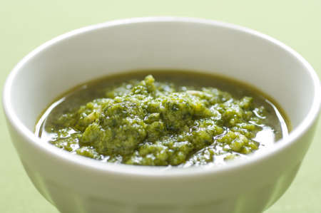 Close-up view of organic italian traditional Pesto sauce in a bowl Stock Photo - 17825138