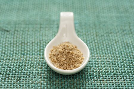 Close-up view of organic Gomasio in a ceramic spoon Stock Photo