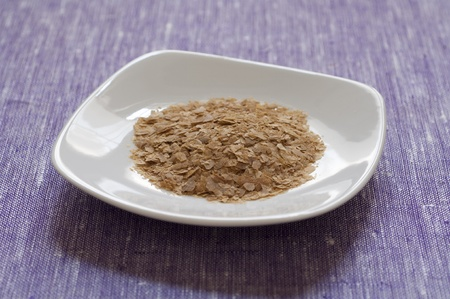 Close-up view of organic nutritional yeast flakes in a dish Stock Photo
