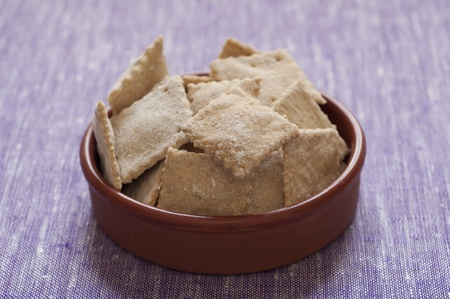 Close-up view of organic homemade Spelt Crackers in a terracotta bowl Stock Photo - 18119497