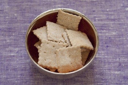 Close-up view of organic homemade Spelt Crackers in a bowl Stock Photo