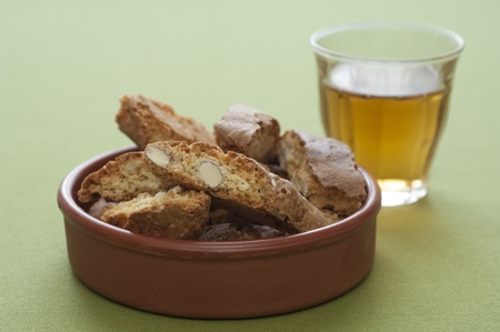 vin: Close-up view of Italian original Cantucci and Vin Santo Stock Photo