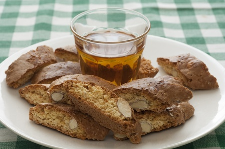 Close-up view of Italian original Cantucci and Vin Santo Stock Photo